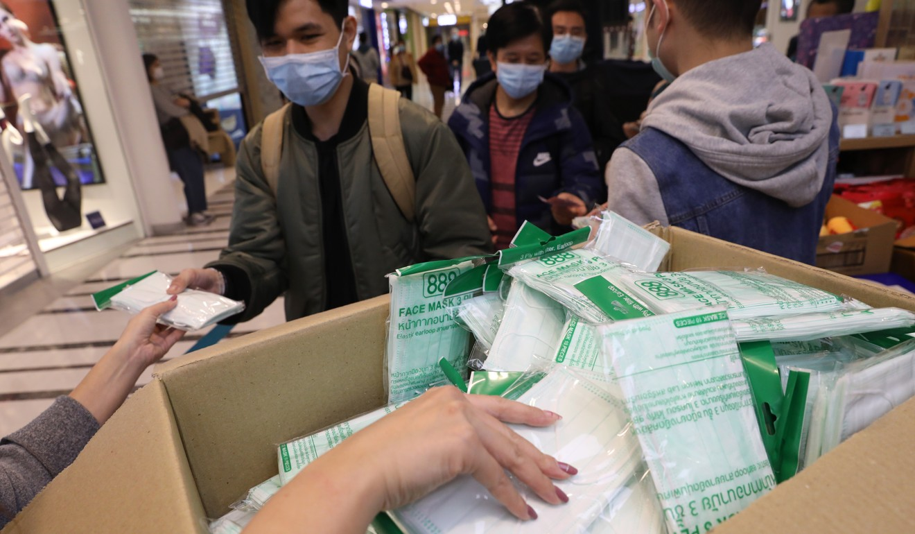 There has been a desperate surge in demand for surgical masks across China as people fear catching the coronavirus. Photo: Winson Wong