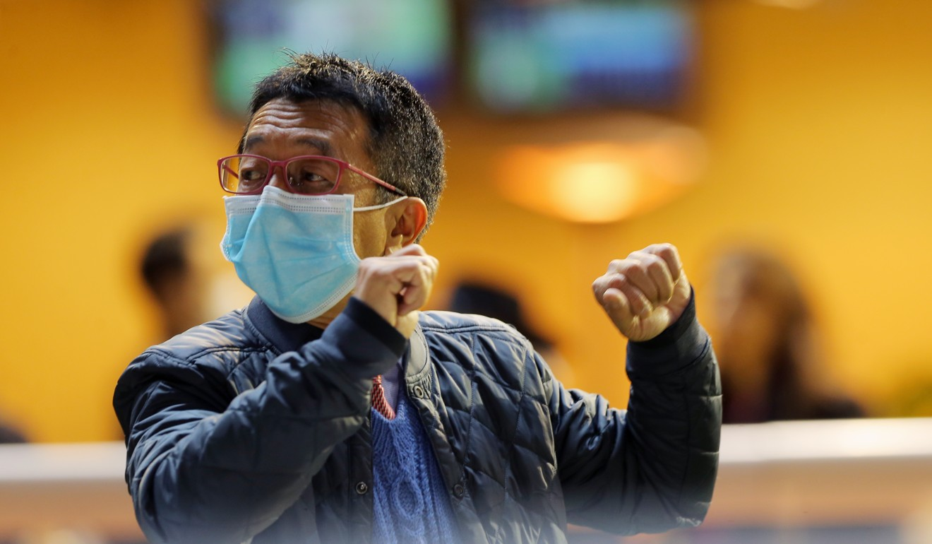 Trainer Me Tsui wears a face mask at Happy Valley on Wednesday night.