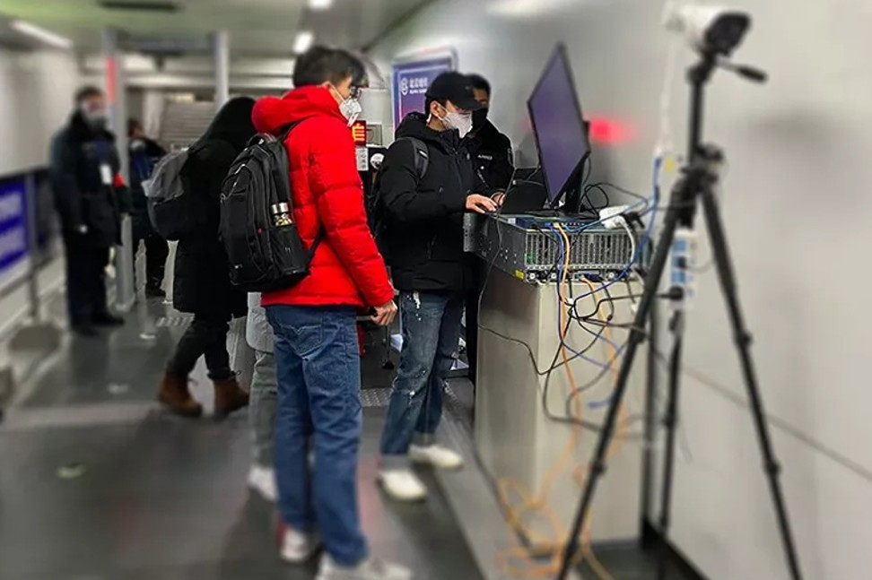 A team from artificial intelligence company Megvii sets up the firm's advanced remote fever detection system at a railway station in Beijing, where the temperature measurements of all commuters are inspected. Photo: Handout