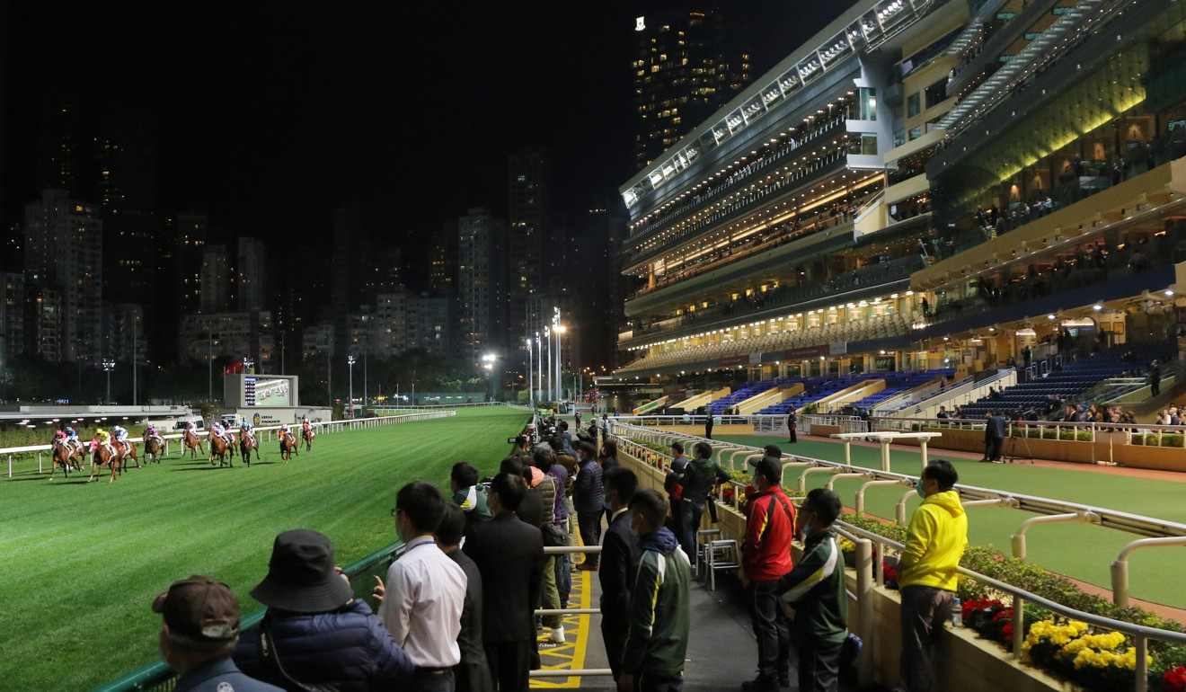 Horses gallop in front of virtually empty stands at Happy Valley on Wednesday.