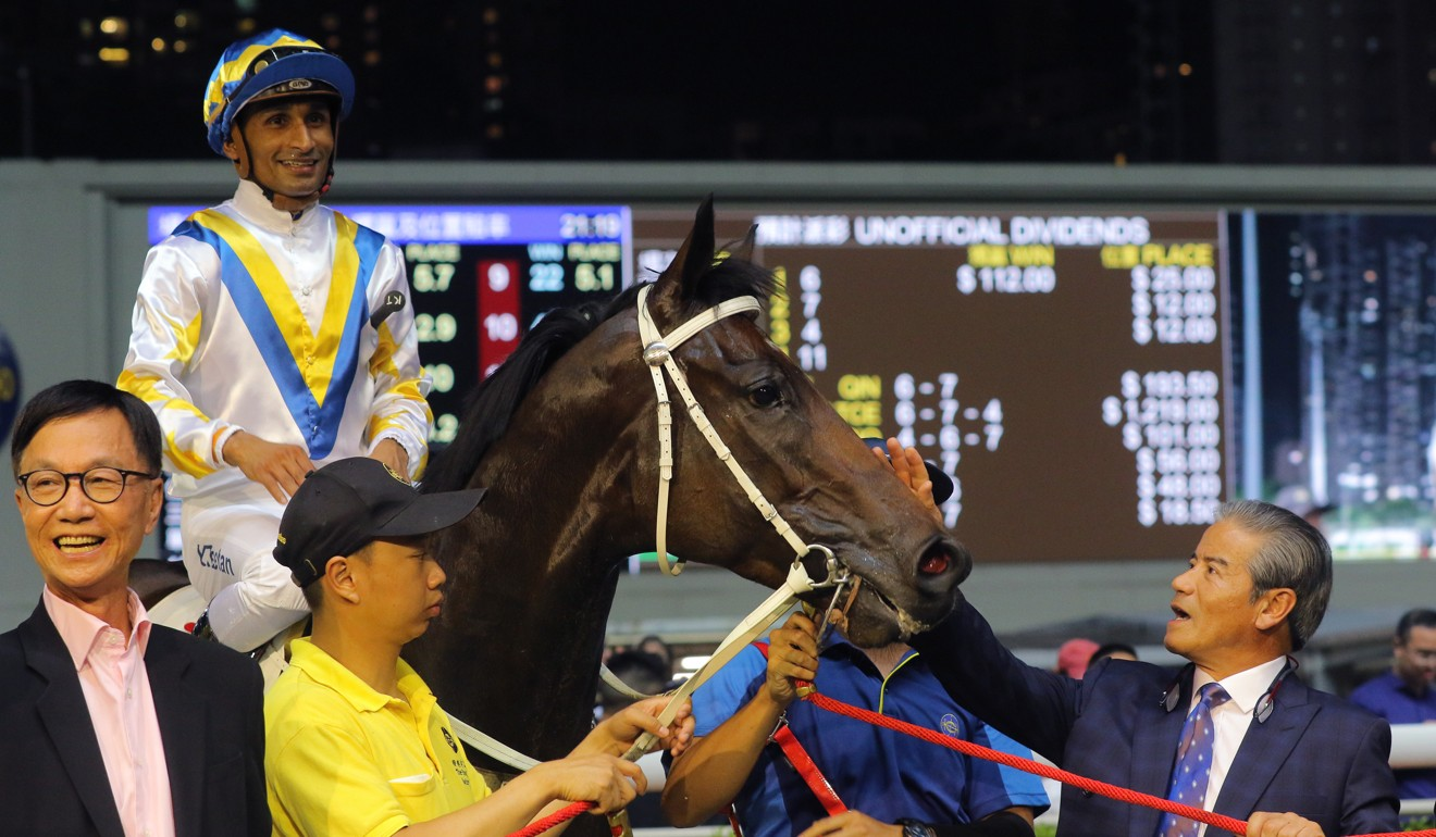 Tony Cruz (right) with Hong Kong Bet after a win.