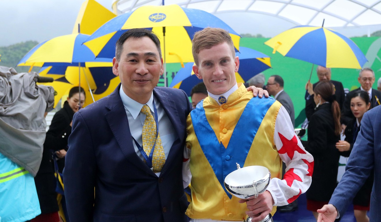 Trainer Michael Chang with jockey Chad Schofield after winning a race in Conghua last season.