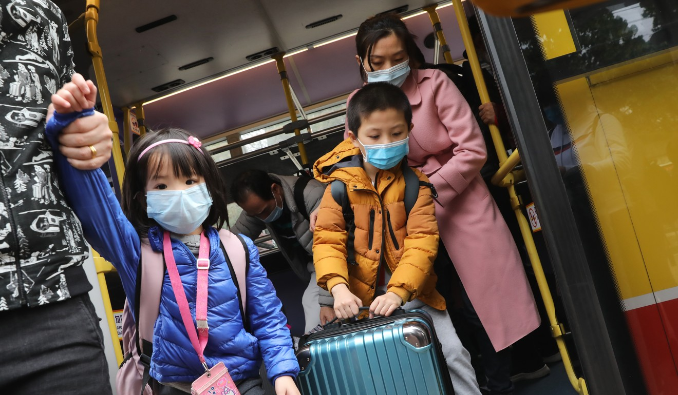 Coronavirus: Hong Kong students and civil servants asked to help monitor people returning from mainland China as mandatory quarantine comes into force