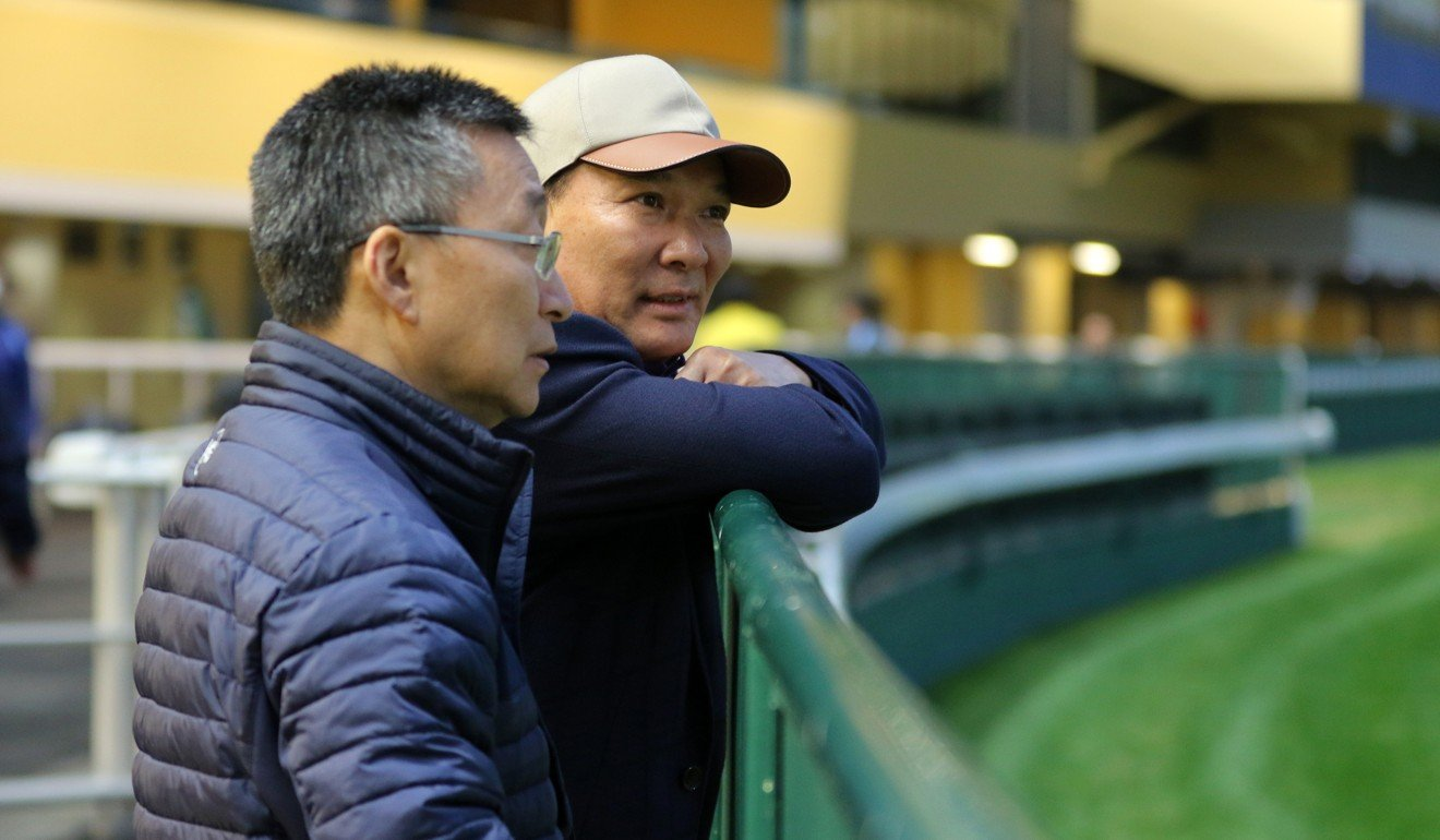 More Than This' owner Huang Kai-wen (right) with trainer Francis Lui.
