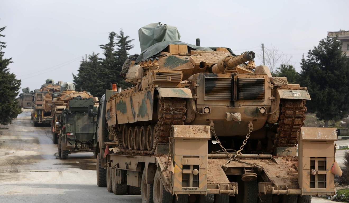 Turkey threatens to hit Syrian targets 'anywhere' as it masses tanks and commandos