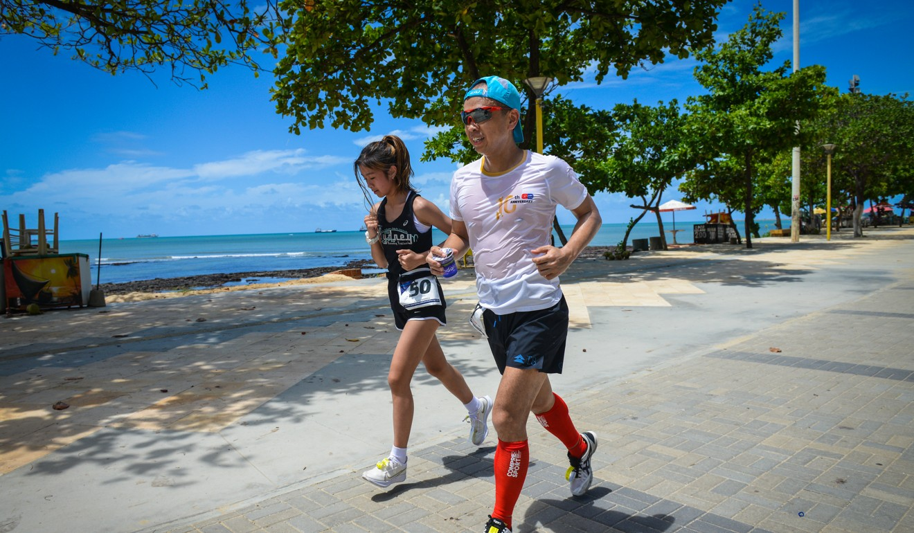Nicole Chik runs with her father.