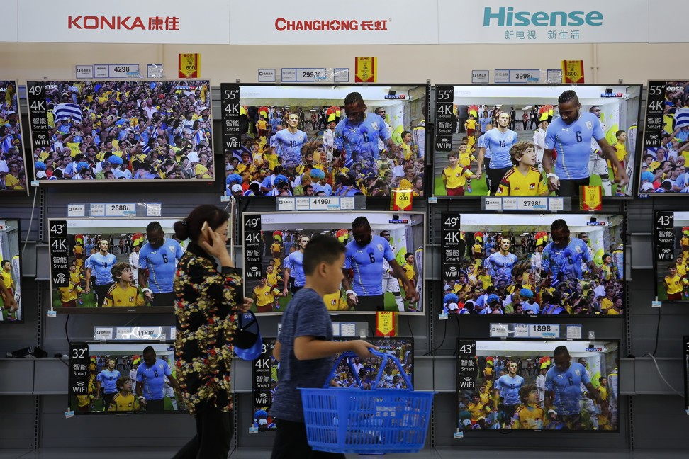 Chinese producers of flat-screen televisions on display at a hypermarket in Beijing on Wednesday, July 11, 2018. Photo: AP