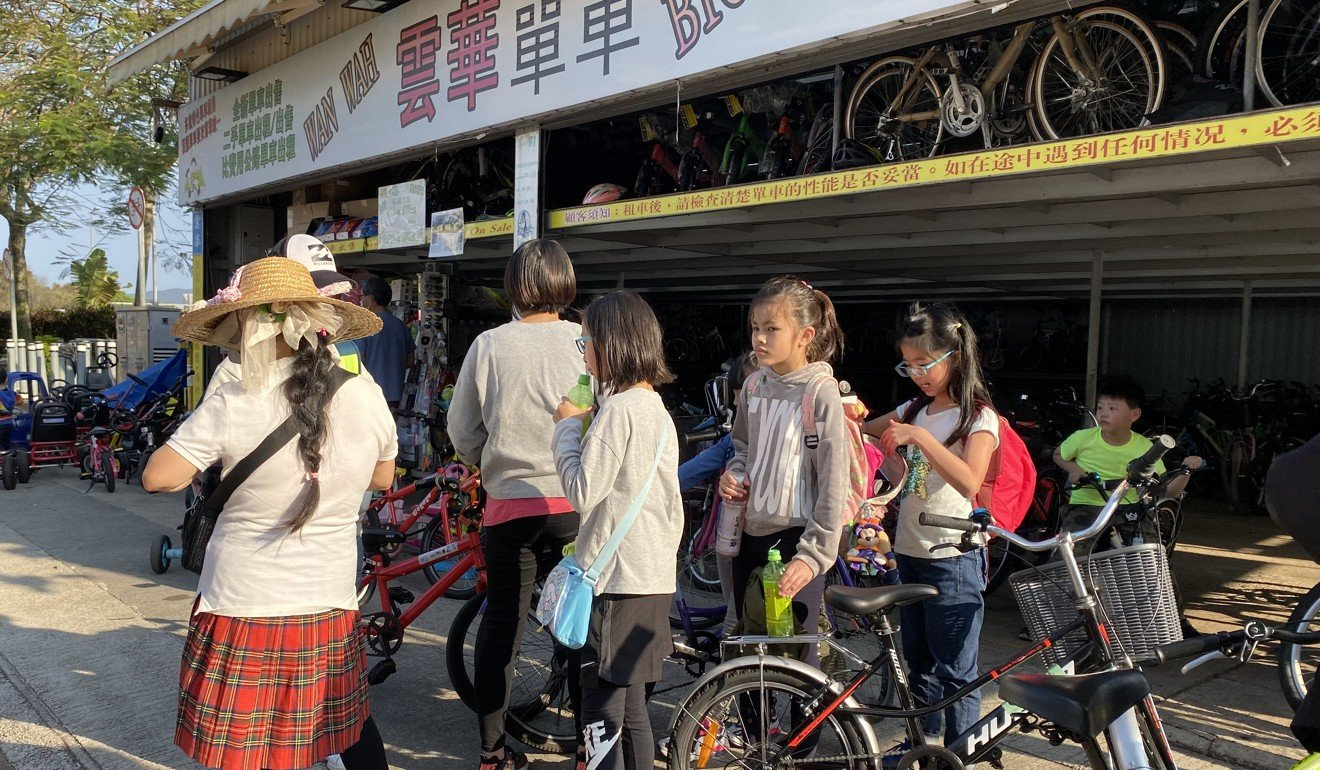 Children at a bicycle rental shop. Photo: Denise Tsang