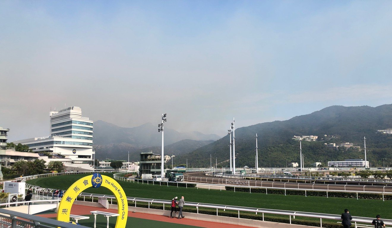 A fire burns in the hills near Sha Tin racecourse.