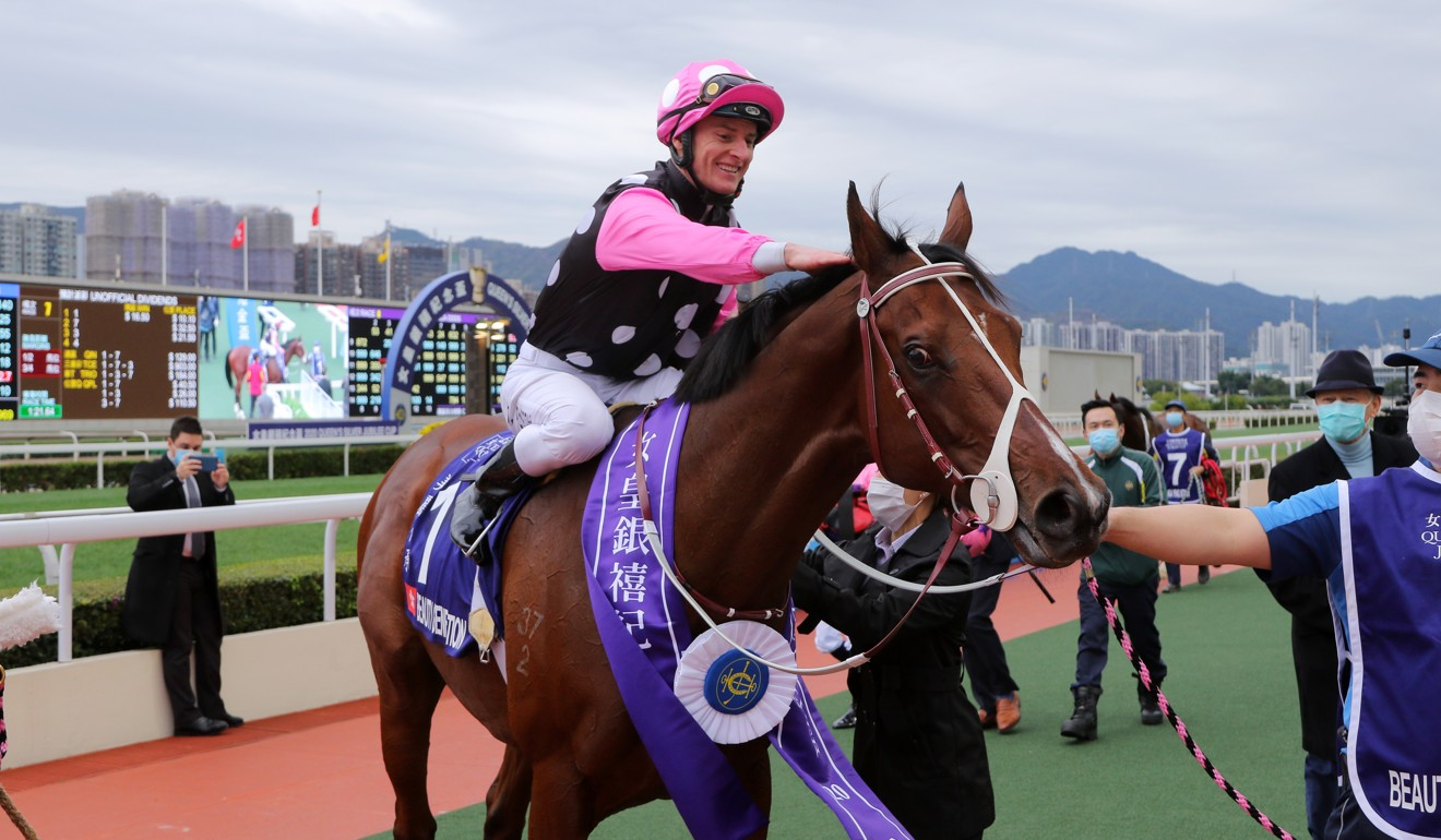 Zac Purton pats Beauty Generation after his win in the Queen's Silver Jubilee Cup.