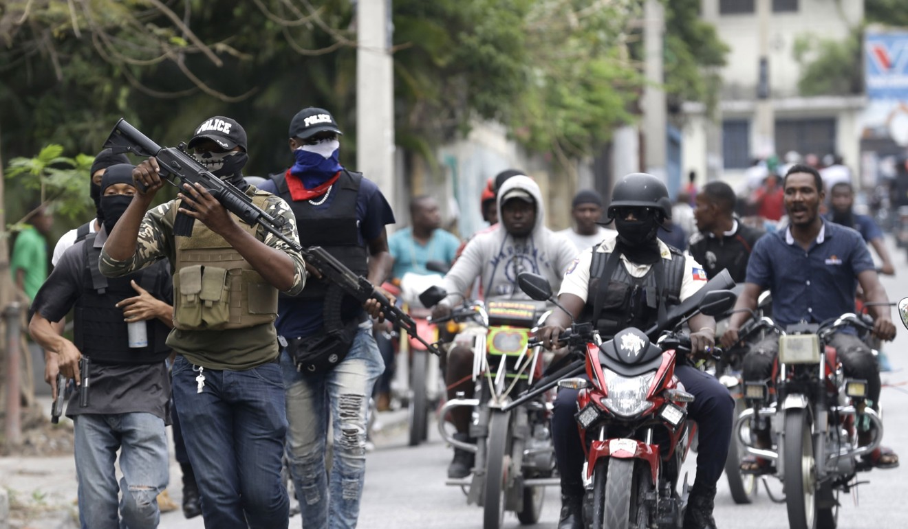 Warlike scenes in Haiti as police and troops shoot at each other over pay
