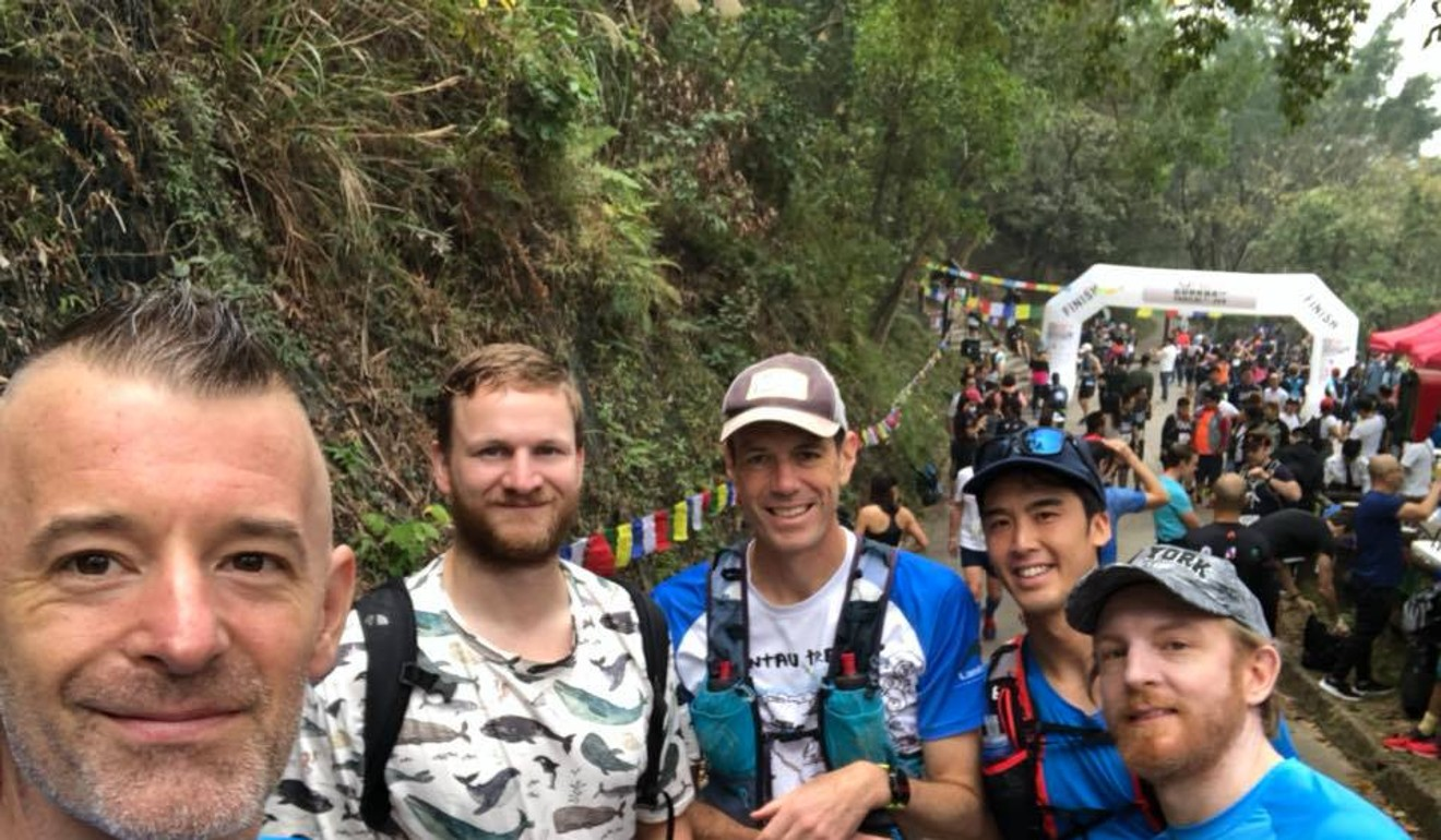 Nic Tinworth (left) defied the odds to finish the 12km Gurkha Trailblazer in the midst of his tumour treatment. Photo: Handout