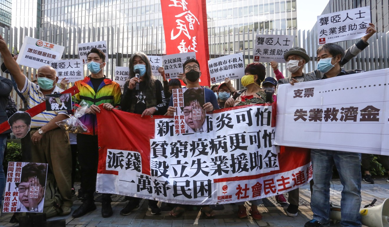 Dozens of members from pro-democracy groups in Hong Kong protested outside the Legislative Council ahead of the budget speech. Photo: Joanathan Wong