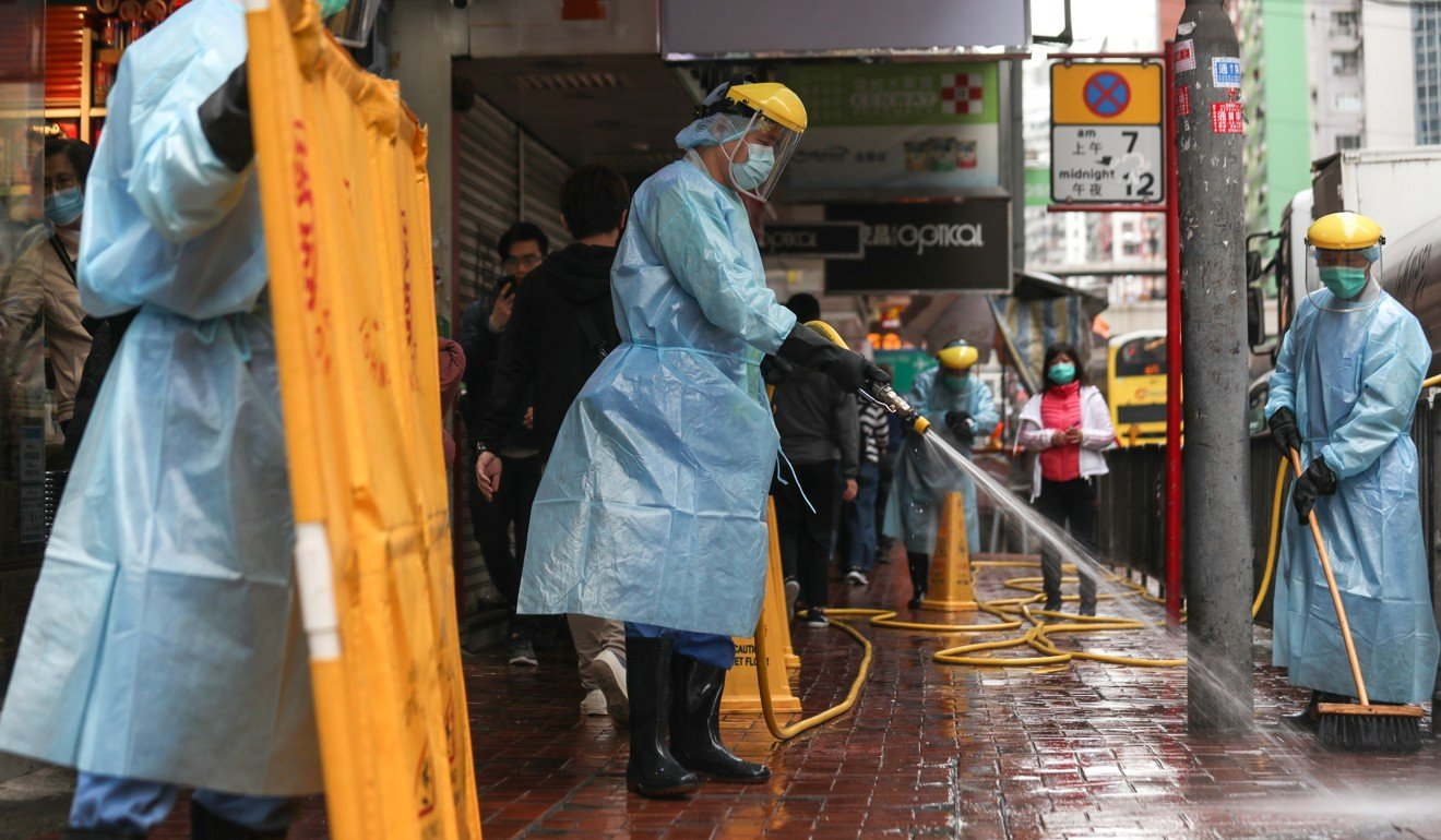 The area outside Fook Wai Ching She Buddhist worship hall on King's Road is cleaned on Tuesday morning. Photo: Xiaomei Chen