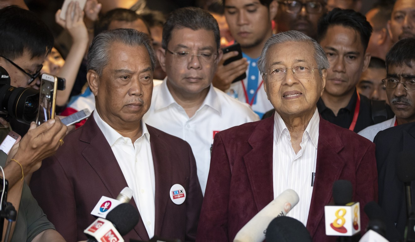 Muhyiddin Yassin is pictured with caretaker prime minister Mahathir Mohamad. Photo: AP