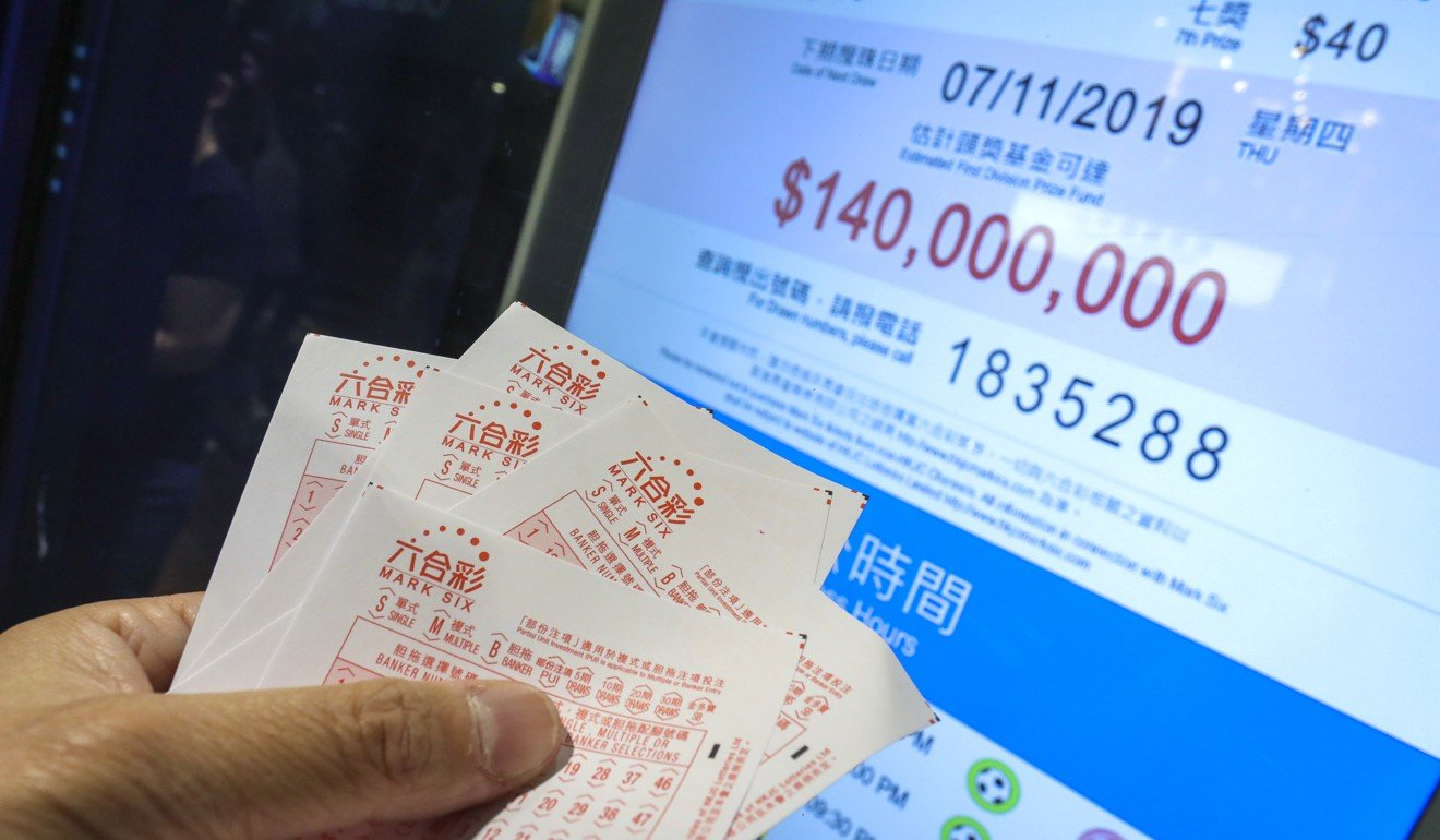 People bet at the Hong Kong Jockey Club betting branch in Wan Chai for the Mark Six draw of HK$140 million. Photo: SCMP/May Tse