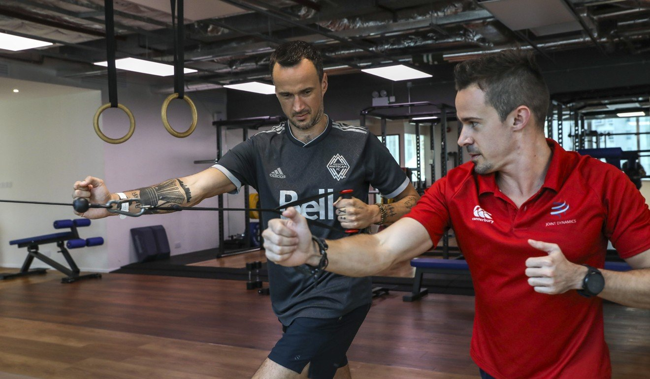 SCMP reporter Patrick Blennerhassett getting his alignment tested with coach Erwan Desvalois at Joint Dynamics in Quarry Bay. Photo: K.Y. Cheng