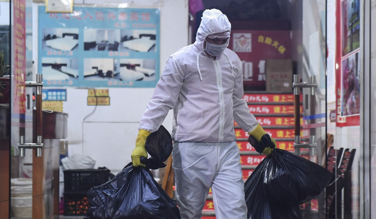 People in Wuhan frequently reuse their face masks to reduce waste. Photo: Xinhua