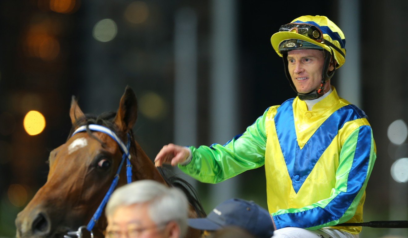 Zac Purton celebrates Tangmere's victory at Happy Valley.