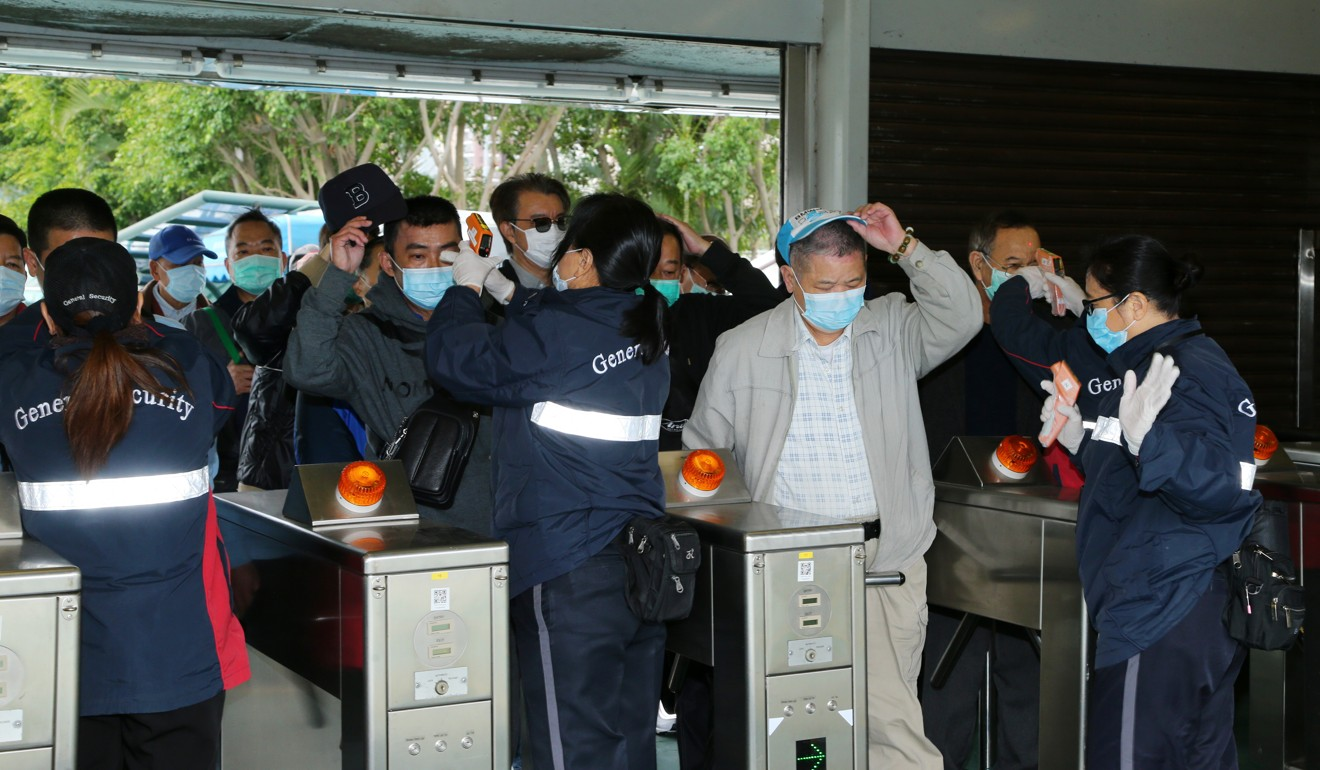 Customers undergo temperature screening to enter Sha Tin on Thursday.