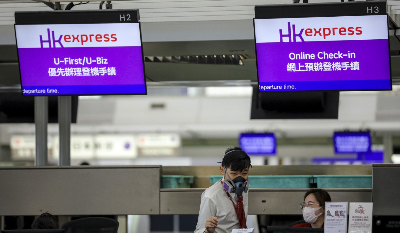 Travel has almost ground to a halt with empty check-in desks at the Hong Kong International Airport. Photo: Winson Wong