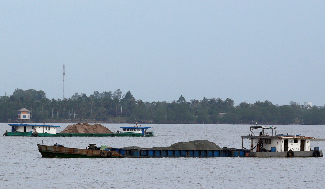 Ships transport sand on the Mekong River in Vietnam. Photo: Reuters