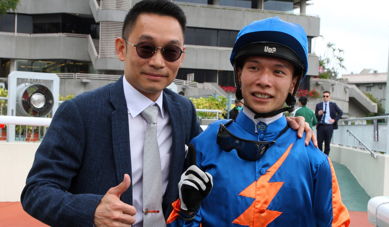 Trainer Jimmy Ting and jockey Victor Wong celebrate their victory.