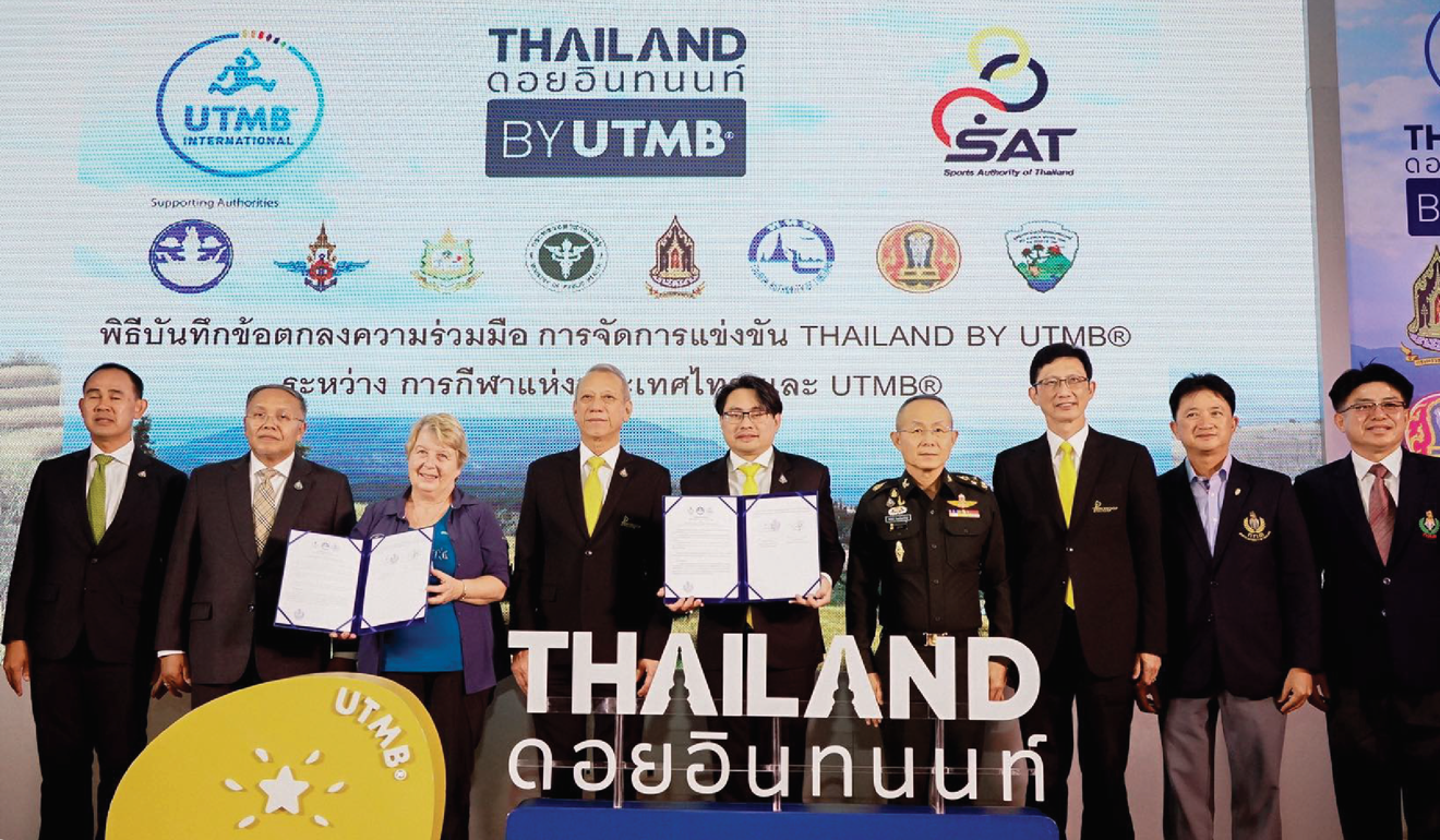 UTMB co-founder Catherine Poletti with Thai authorities announcing the signing of the agreement between UTMB International and Sports Authority of Thailand. Photo: Thailand by UTMB