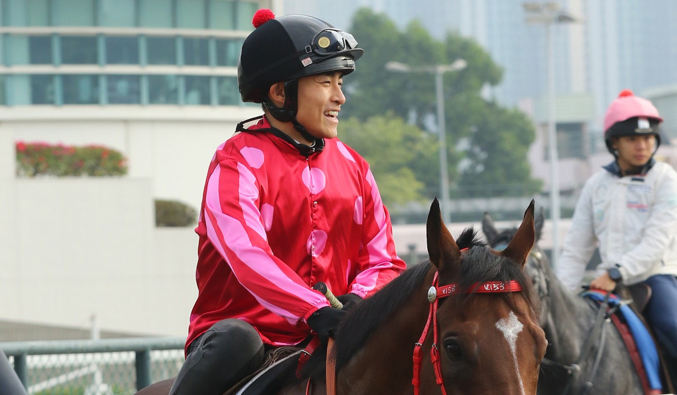Keith Yeung is all smiles at trackwork.