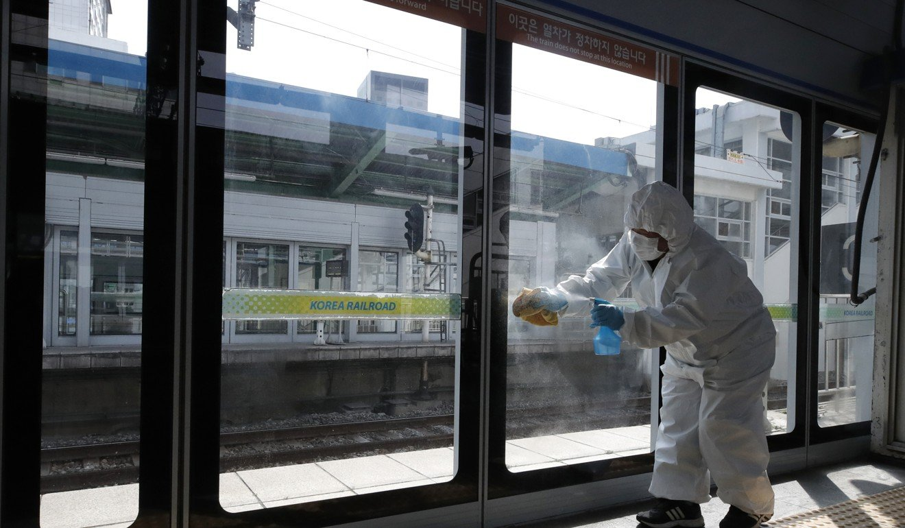A worker disinfects a Seoul subway station as a precaution against the new coronavirus. Photo: AP