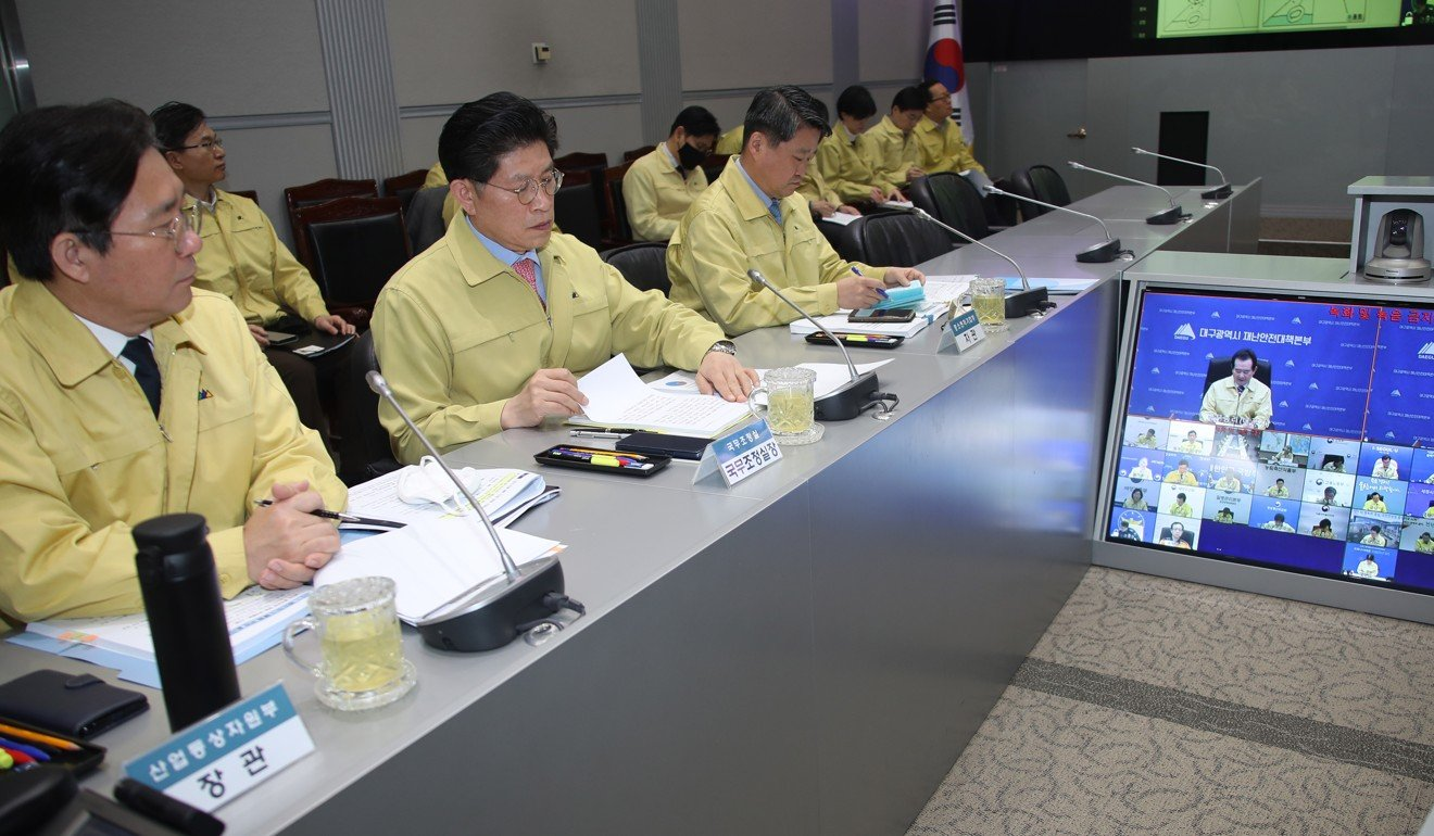 South Korean ministers listen to Prime Minister Chung Sye-kyun (on screen) during a meeting to discuss measures to deal with the spread of the new coronavirus. Photo: EPA
