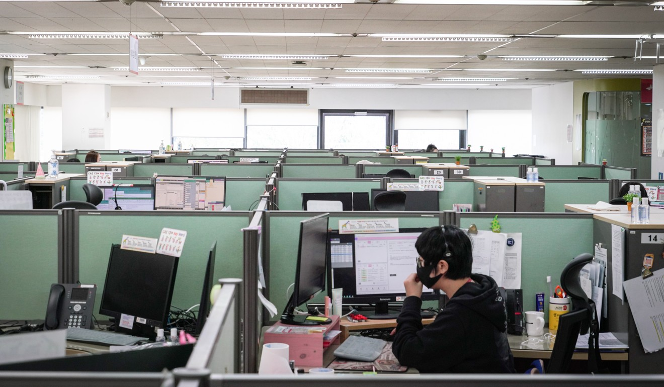 A nearly empty customer call centre in the Gocheok-dong neighbourhood of Seoul as workers isolate or work from home. Photo: EPA