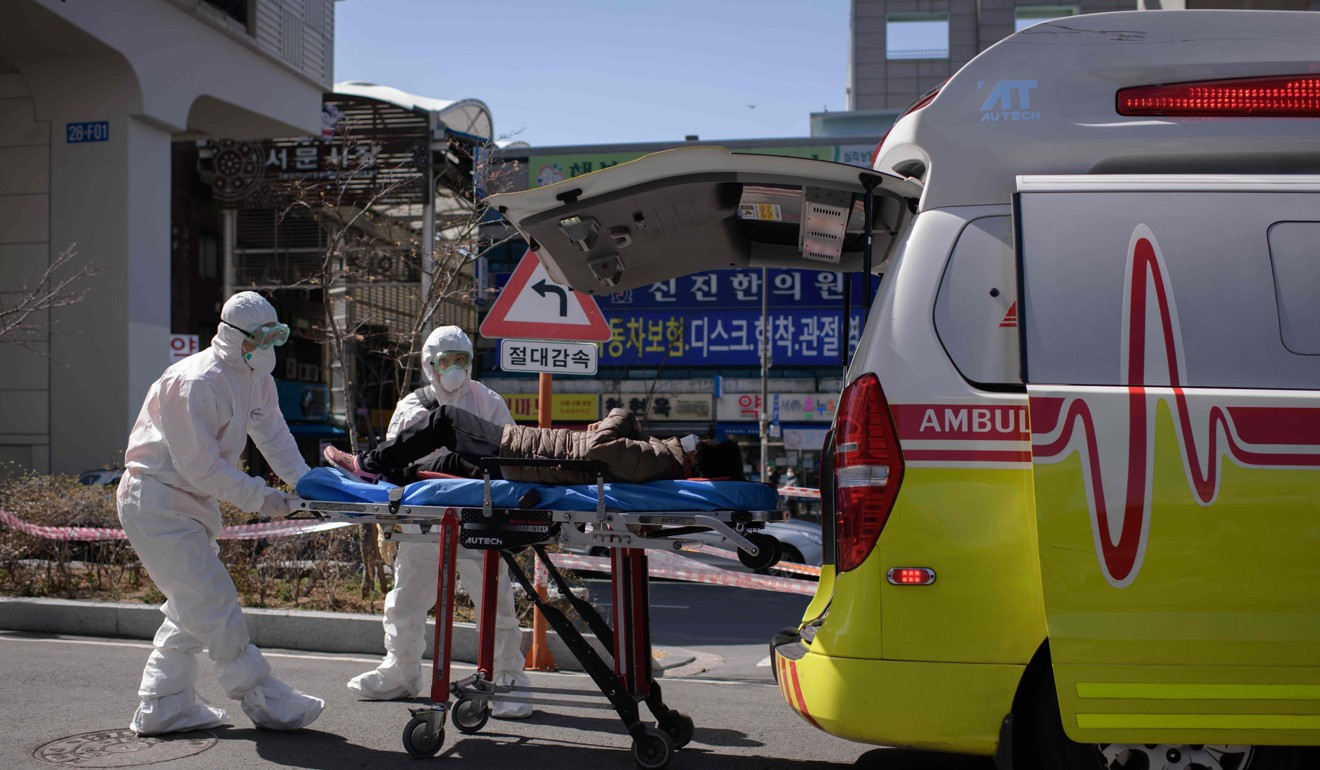 Medical workers attend to a woman who was feeling unwell upon her arrival at the Keimyung University hospital in Daegu. Photo: AFP