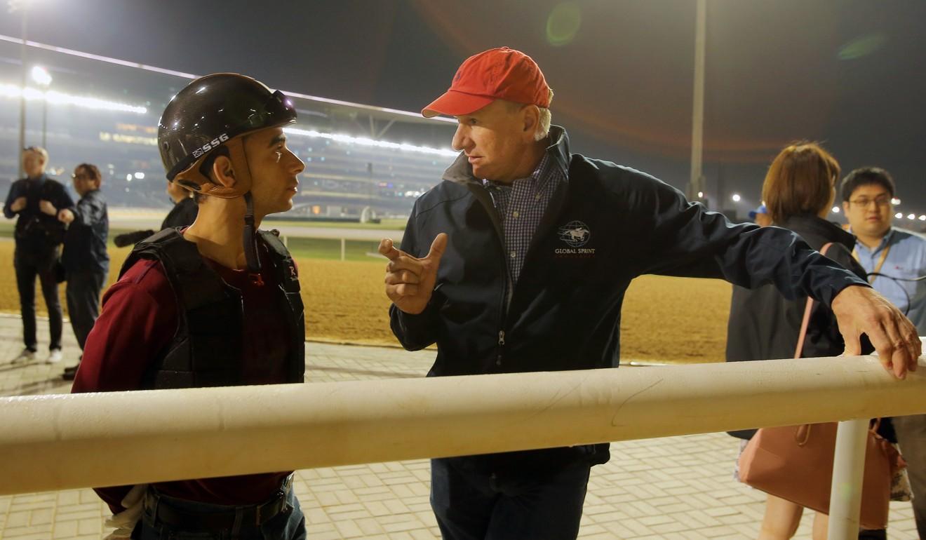 Joao Moreira with trainer Tony Millard at Meydan in 2016.