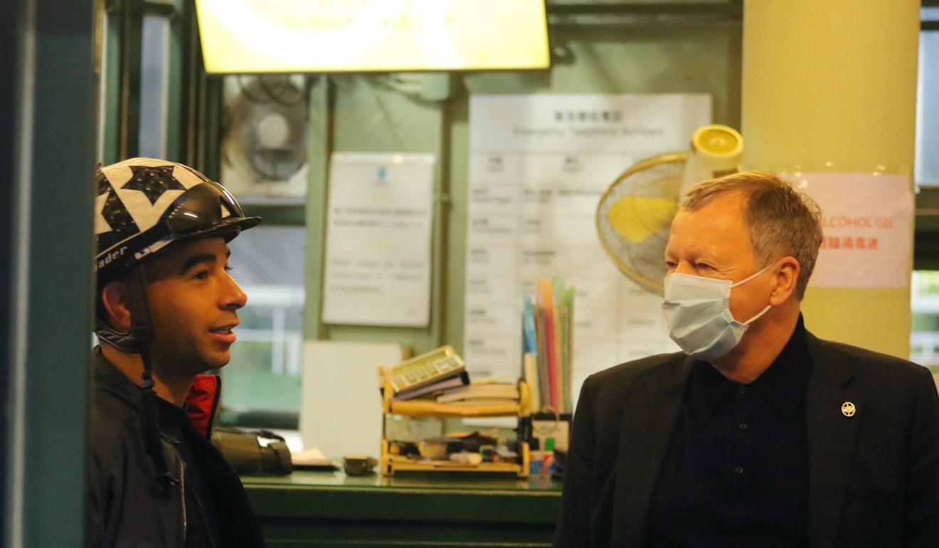 Jockey Club chief executive Winfried Engelbrecht-Bresges chats to jockey Joao Moreira at Sha Tin on Tuesday morning.