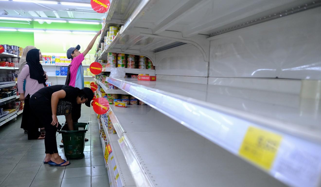 Panic buying has emptied supermarket shelves. Photo: Bloomberg