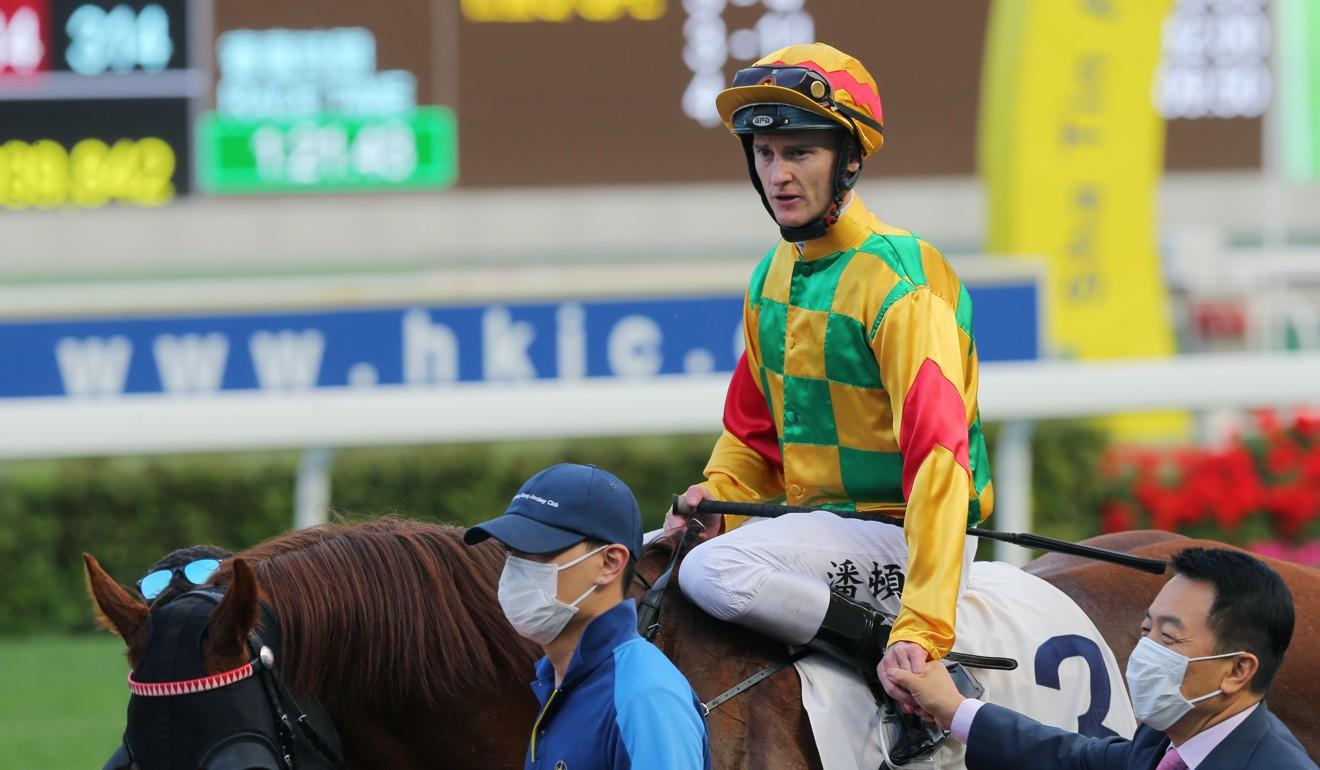 Zac Purton rides a winner at Sha Tin.