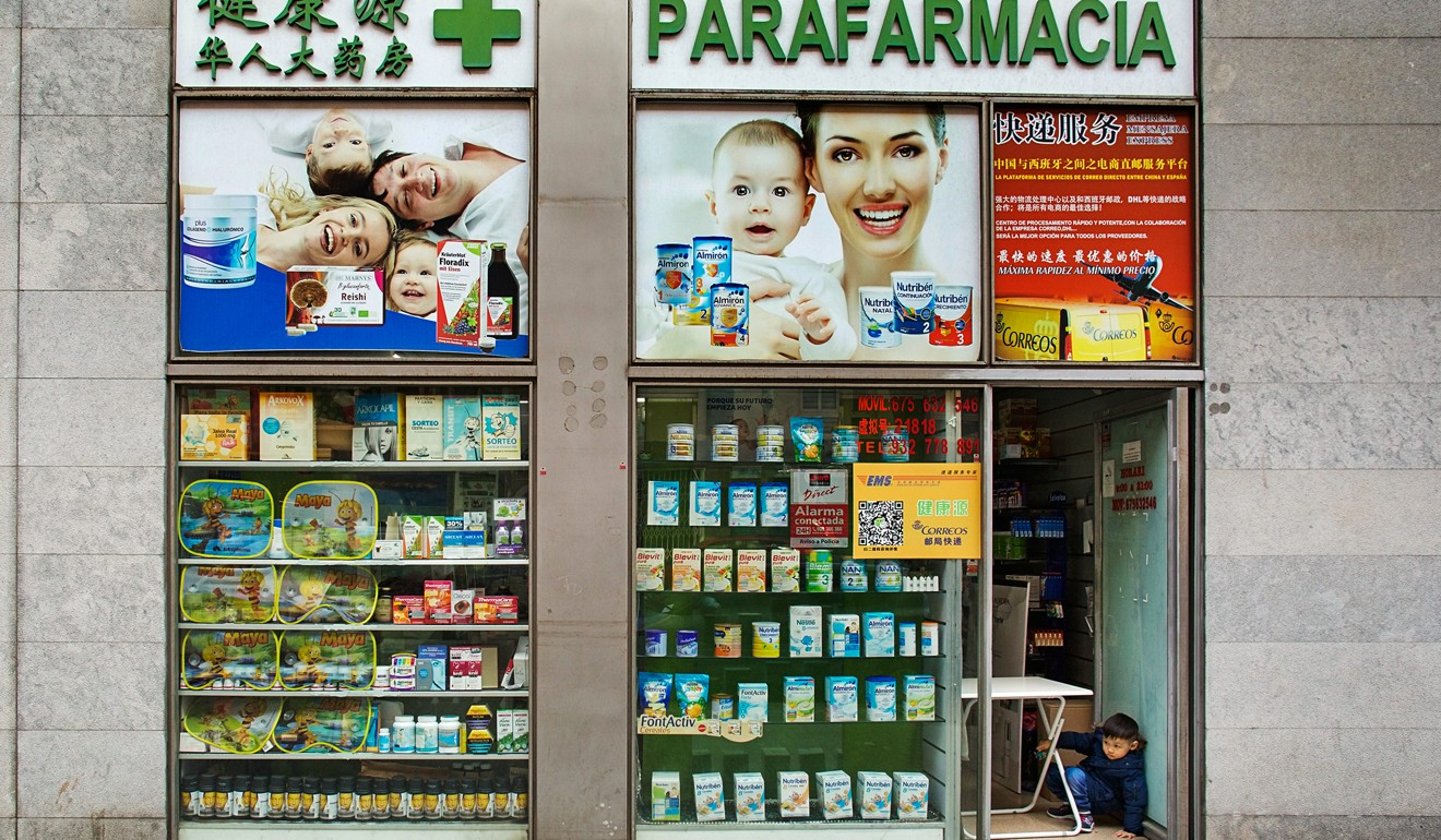 The door is open, but the entrance to this Chinese-run pharmacy in Barcelona is blocked to customers. Photo: Antolin Avezuela
