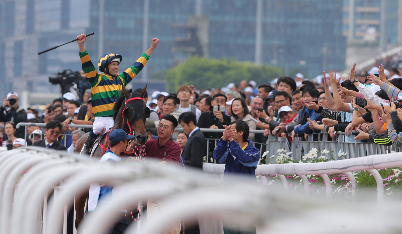 Hugh Bowman celebrates with the fans after winning the Derby with Furore.