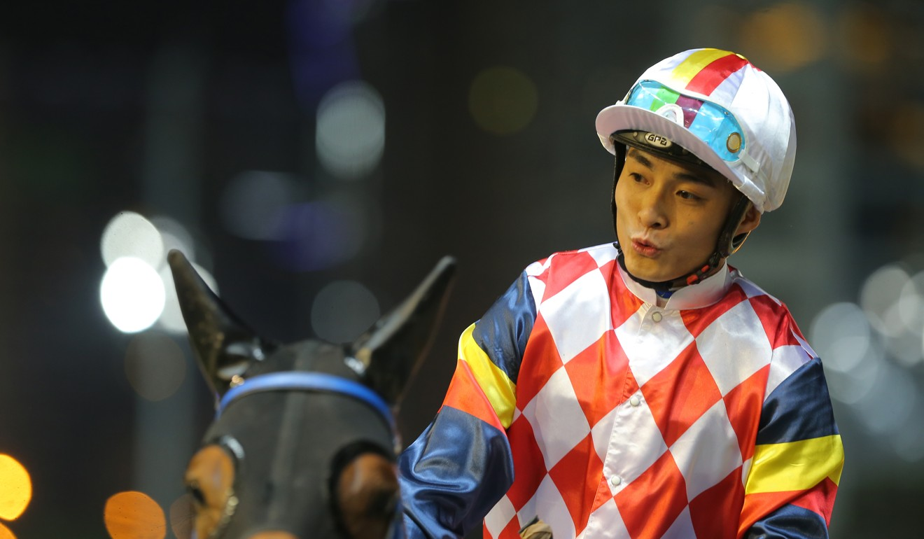 Keith Yeung celebrates his win on Hardly Swears at Happy Valley.