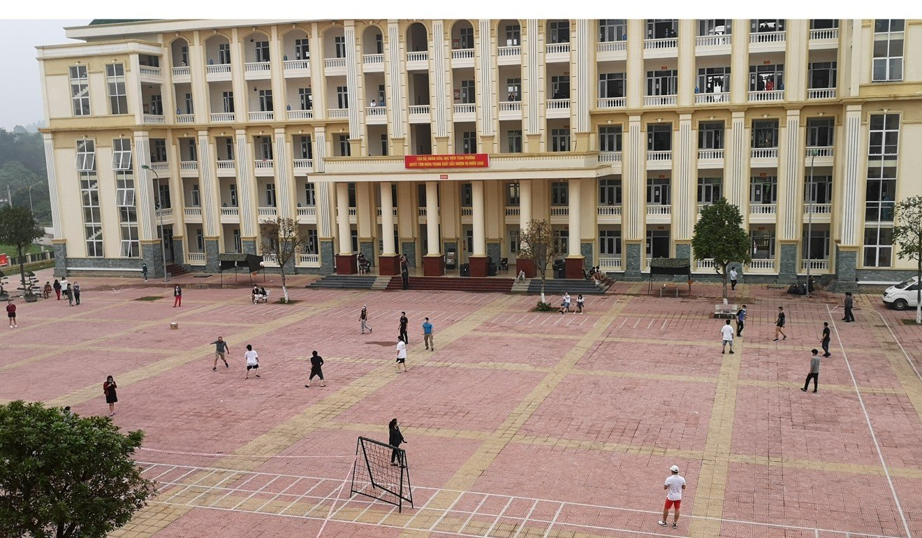 People play sports in groups on the courtyard at Son Tay Military School quarantine camp in Hanoi. Photo: Gavin Wheeldon