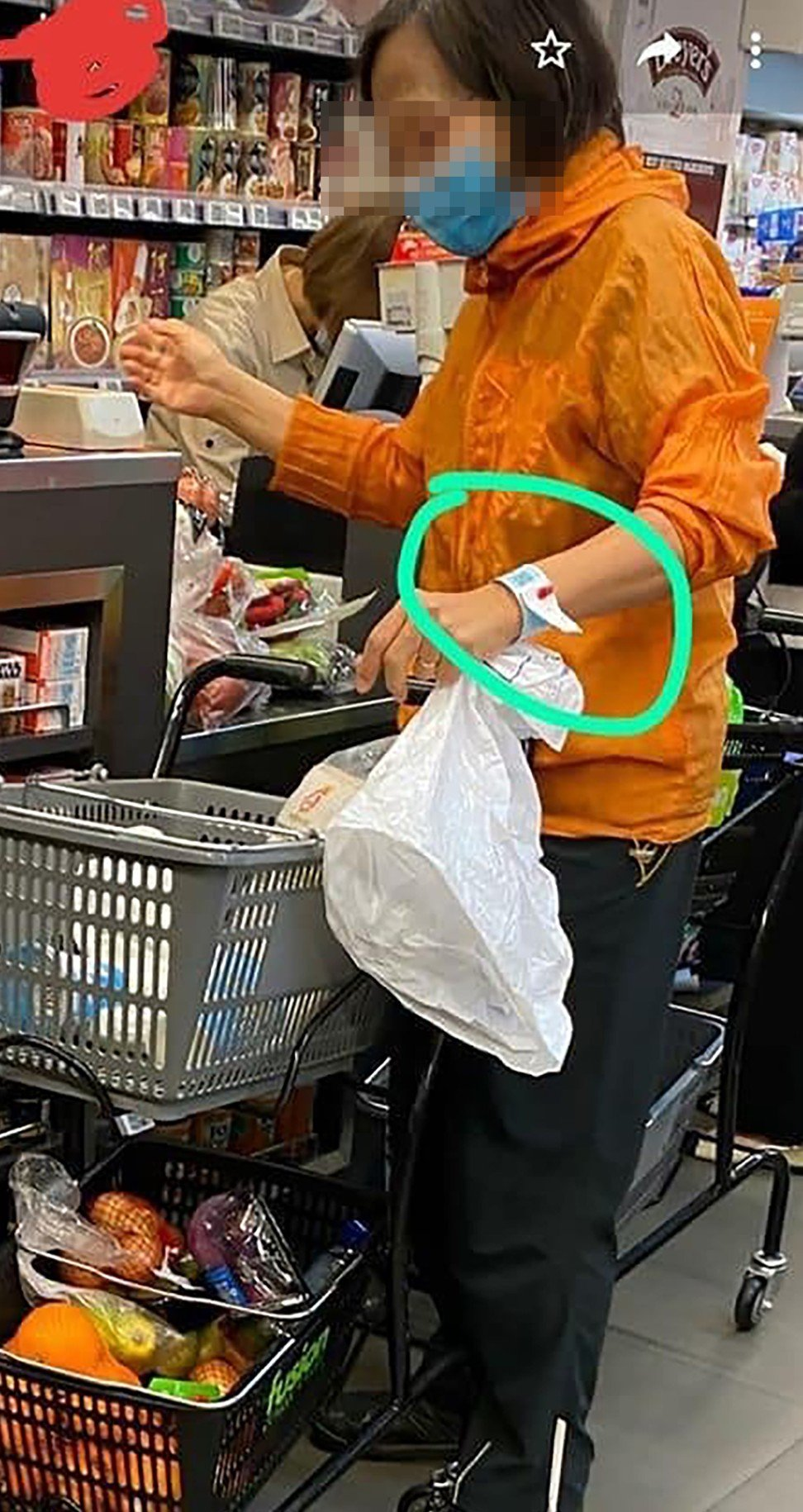 A woman with a quarantine wristband was spotted at a supermarket in Whampoa on Monday. Photo: Facebook