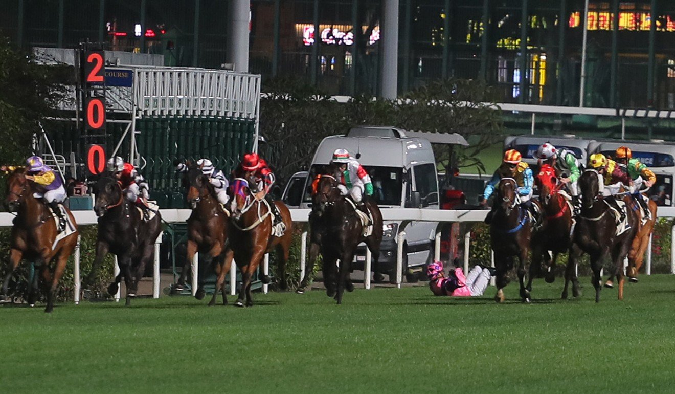 Jockey Vagner Borges falls during a race at Happy Valley on Wednesday night.
