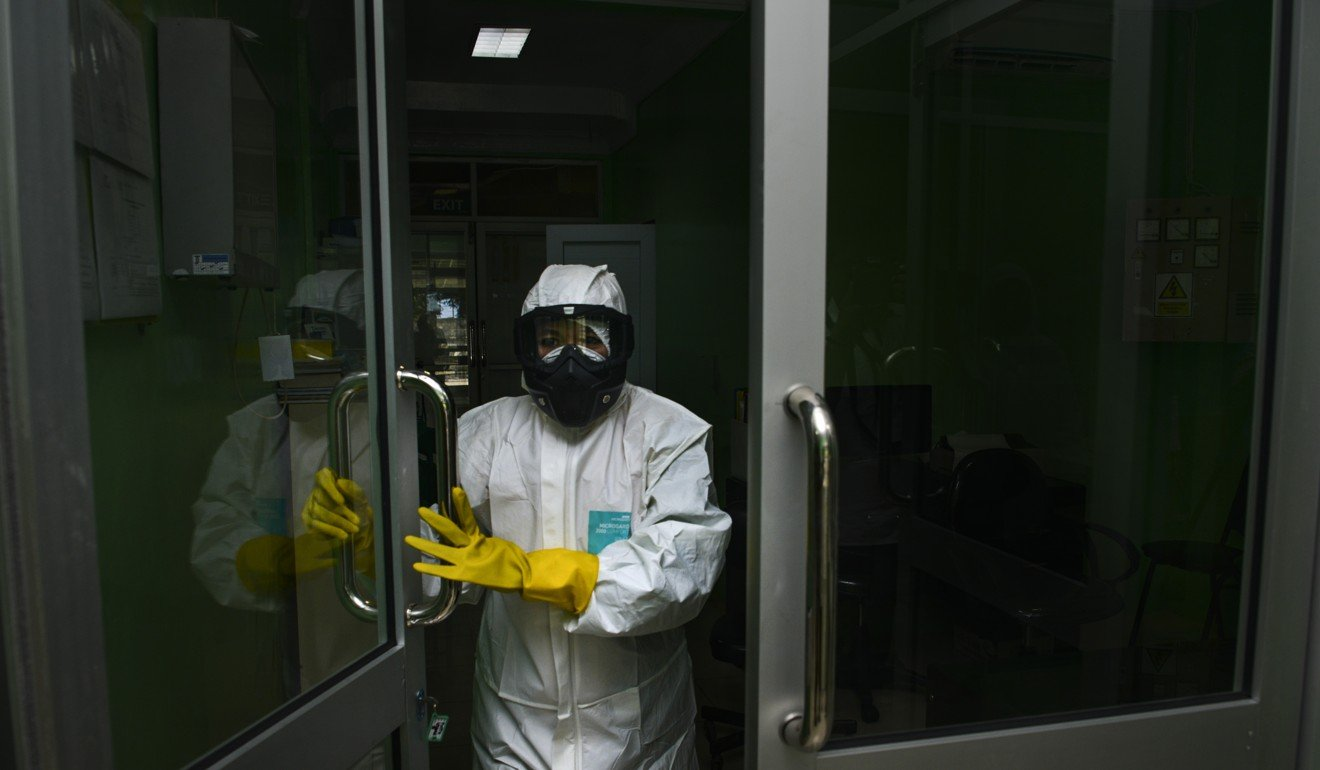 A health worker in protective gear walks into a quarantine room at a hospital in Banda Aceh, Indonesia. Photo: AFP