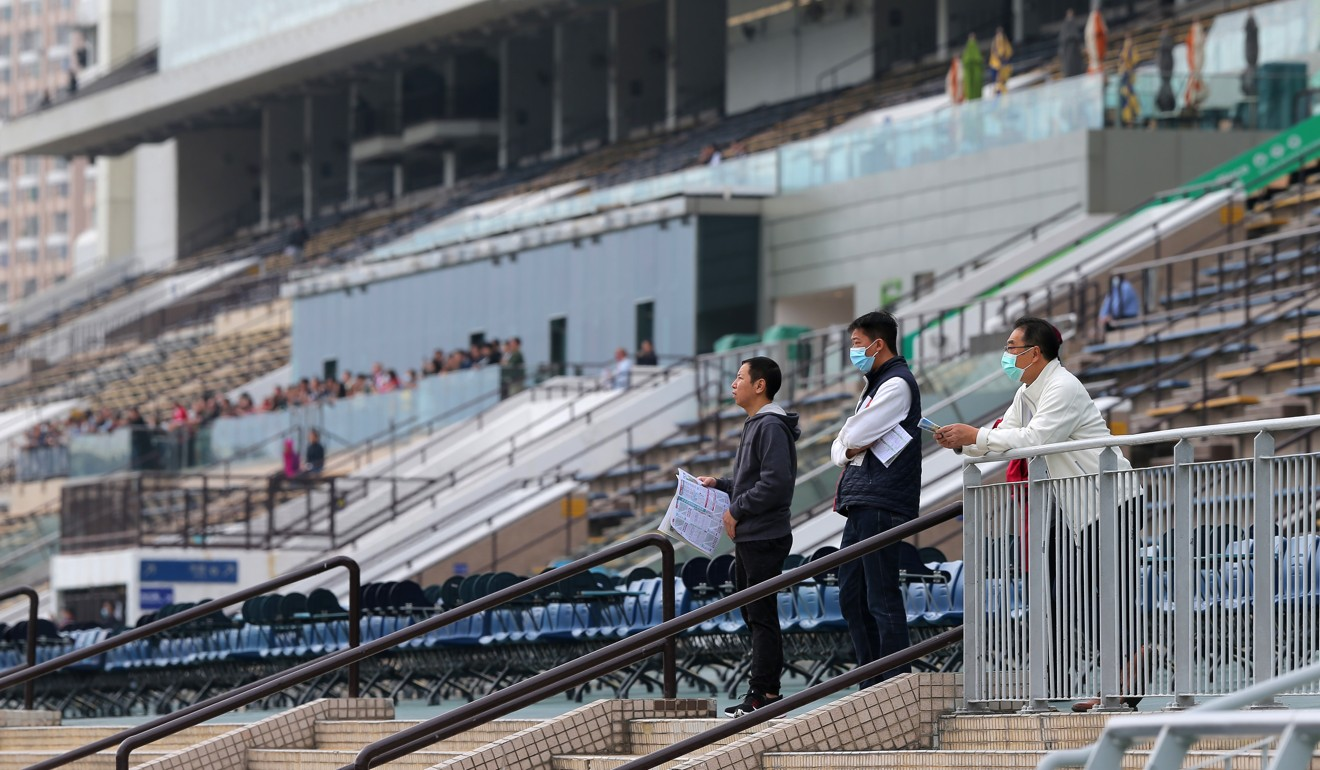 Three fans watch the races at Sha Tin in February.