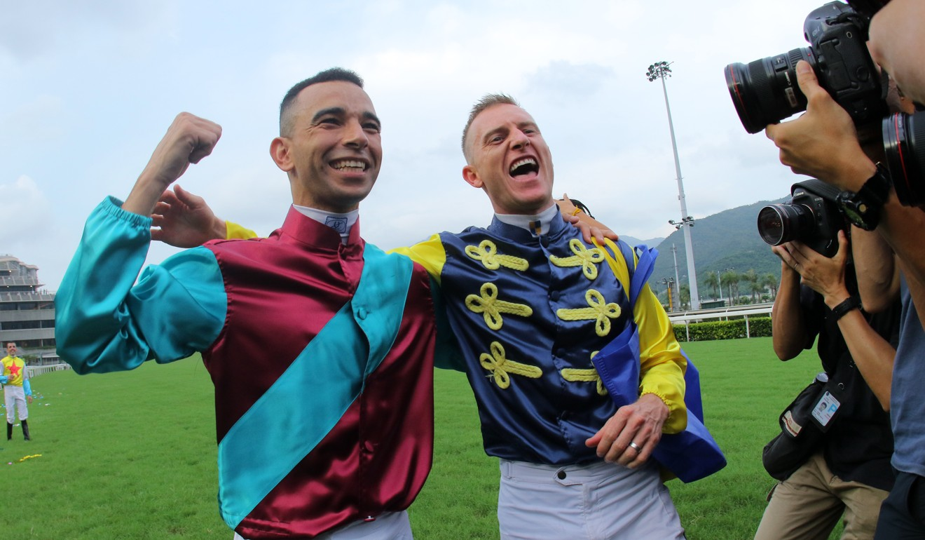 Joao Moreira (left) and Zac Purton ham it up for the cameras at the end of last season.