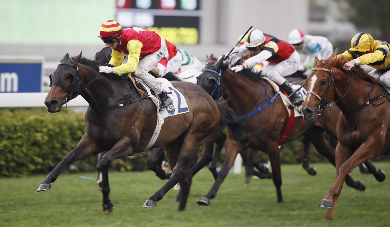 Zac Purton dashes clear on Grade One to win at Sha Tin on Sunday.