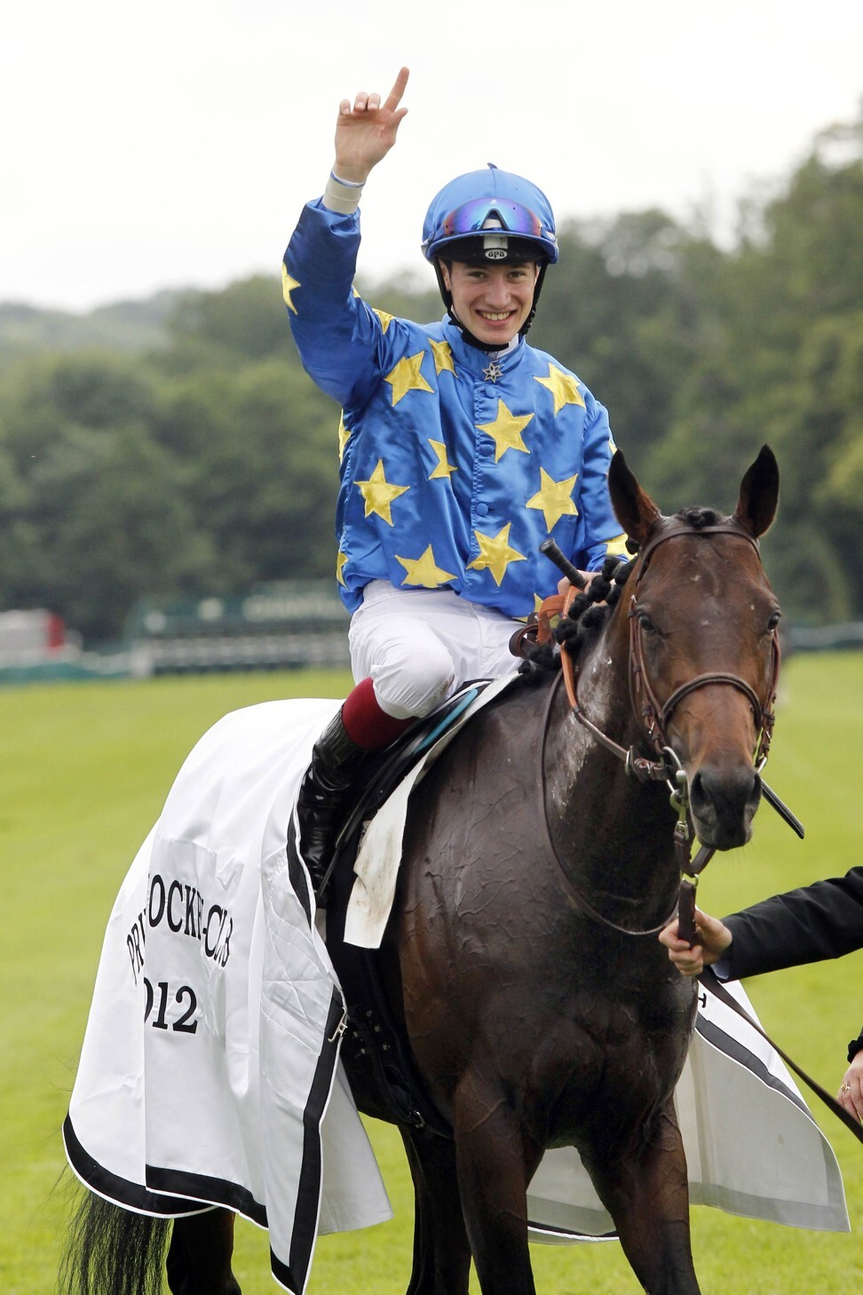Antoine Hamelin ridding Saonois, celebrates his victory in the French Derby. Photo: AFP
