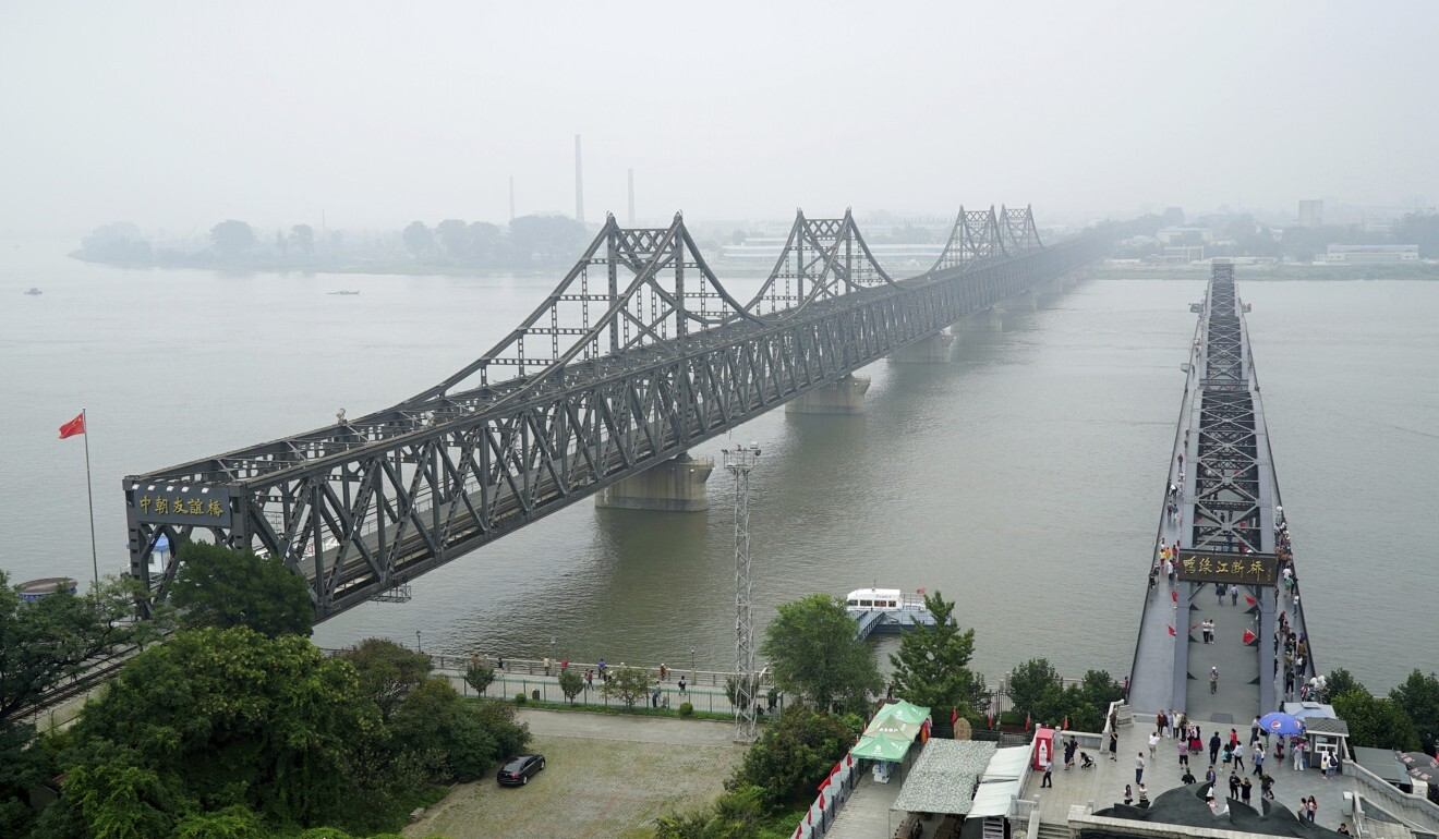 The Yalu River Broken Bridge (right) next to the Friendship Bridge in Dandong, Liaoning province, connecting North Korea and China. Photo: AP/Emily Wang