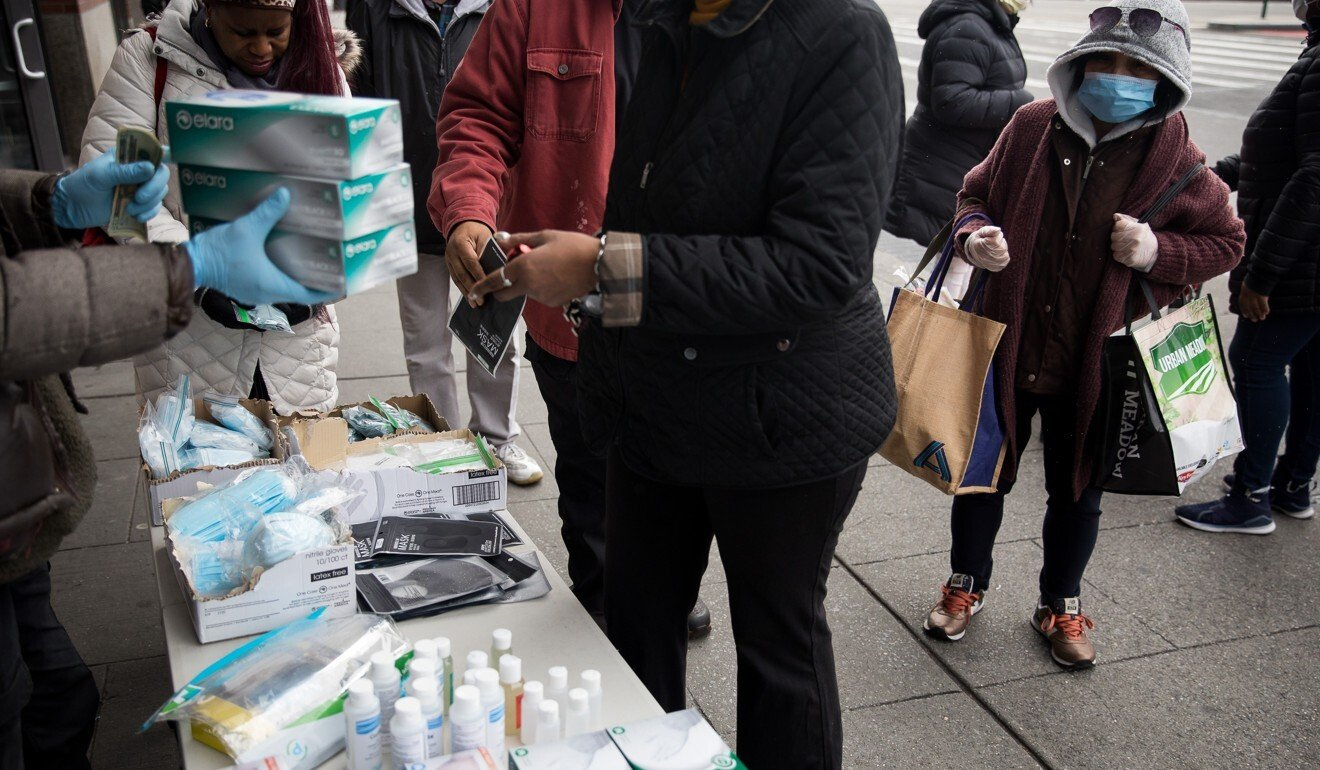 A vendor hawks face masks and other hygiene products in New York. Photo: Xinhua